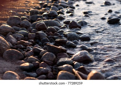 Rocks between the sand beach and the water
