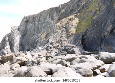 rocks at the bottom of a cliff landslide