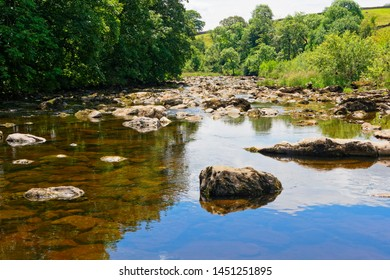 Rocks and boulders of all sizes litter the River Ribble near Stainforth in the Yorkshire Dales