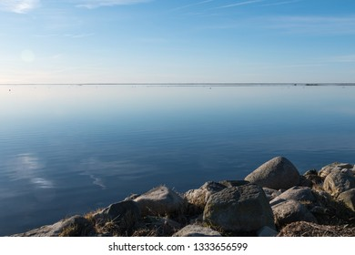 Rocks by a coast with absolutely calm water at the swedish island Oland in the Baltic Sea