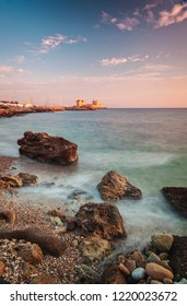 Rocks by the sea in Rhodes town, Greece.