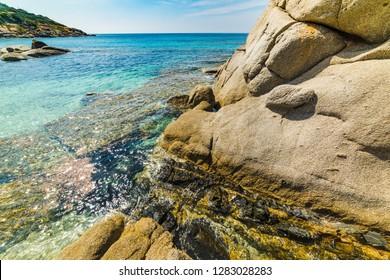 Rocks and clear water in Cala Caterina beach in Villasimius. Sardinia, Italy