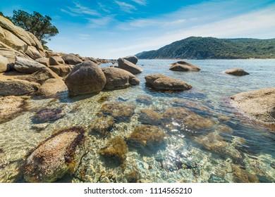 Rocks and clear water in Cala Pira beach in Villasimius. Sardinia, Italy