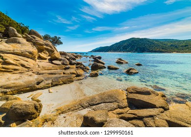Rocks and clear water in Cala Pira shore. Sardinia, Italy