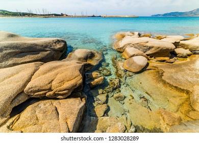 Rocks and clear water in Spiaggia del Riso in Villasimius. Sardinia, Italy