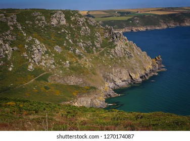 Rocks, cliffs over the sea close to the city of Salcombe, southern England, UK
