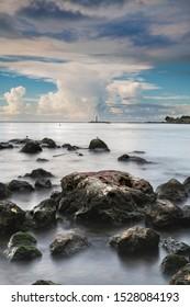 Rocks in Cojimar river mouth. Long exposure shot.