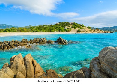 Rocks in crystal clear sea water of Villasimius beach, Sardinia island, Italy