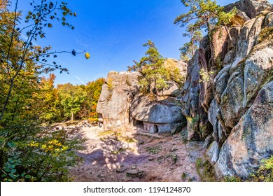 Rocks of Dovbush in the fall, natural and man-made caves carved into stone in the forest in Ukrainian Carpathians.