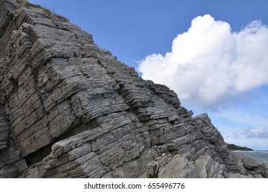 Rocks formation with blue sky and white cloud.