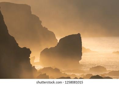 rocks with haze on coast