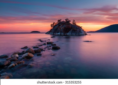 Rocks leading to Whyte island at high tide, Whytecliff park in West Vancouver, British Columbia at Dusk