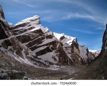 The rocks in the mountain gorge are covered with the first snow