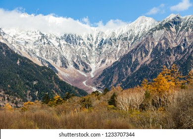 rocks and mountains in snow around at autumn in Kamikochi, Japan
