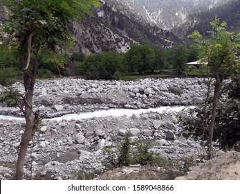 rocks mountains trees glacier water