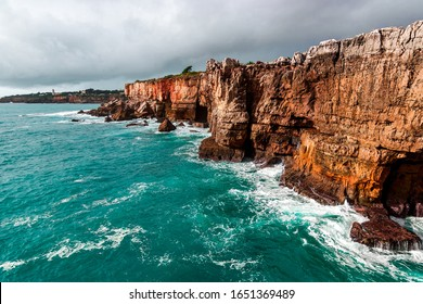 Rocks and ocean before the storm. Amazing view at Boca do Inferno, Hell's Mouth, Cascais, Portugal