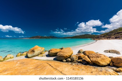 Rocks on the amazing Whitehaven Beach with white sand in the Whitsunday Islands, Queensland, Australia
