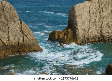Rocks on the beach. Dramatic view of rocky coastline in Santander, Spain.