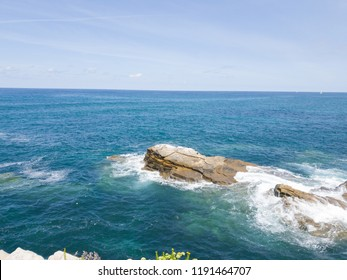 the rocks on the blue horizon of the sea