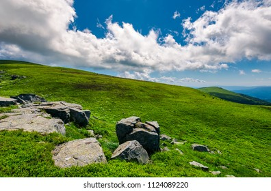 rocks on the edge of grassy meadow on hillside. lovely landscapes of Runa mountain
