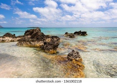 Rocks on Elafonisi beach with crystal turquoise water, island of Crete, Greece. Europe.