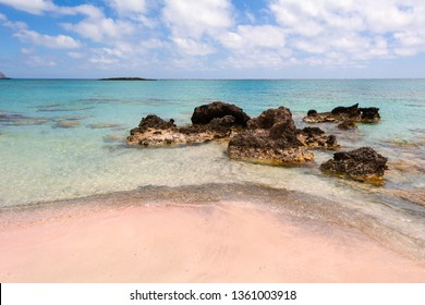 Rocks on Elafonisi beach with pink sand and crystal clear water. Crete Island, Greece