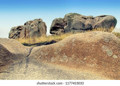 Rocks on Pink Granite Coast which have been sculpted by the sea into varied shapes and patterns, in Perros-Guirec, Ploumanach, Brittany, France