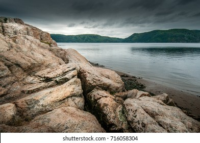 Rocks on the shore of the Saguenay Fjord, on a rainy day in the Baie-Sainte-Marguerite area of Quebec