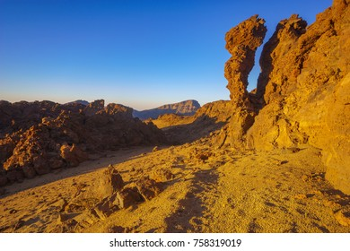 rocks on the Teide volcano in the light of the rising sun