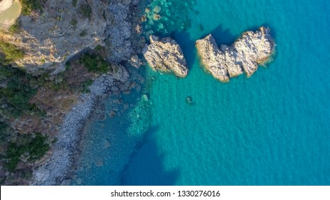 Rocks over the ocean, overhead downward view.