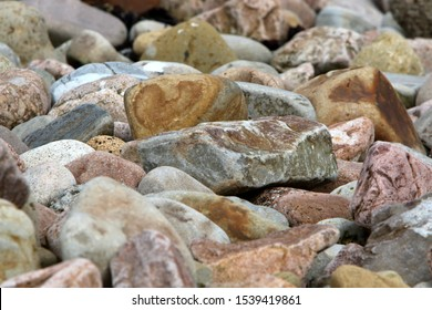 Rocks and pebbles of different sizes and colous