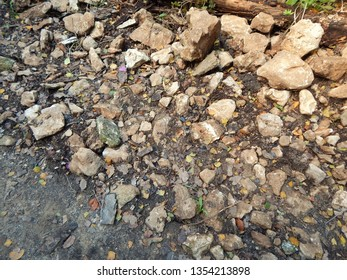Rocks and pebbles litter the side of a trickling brook in Polis, Cyprus