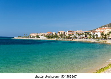 The rocks and pebbles of the shoreline in Ajaccio in Corsica on a sunny day