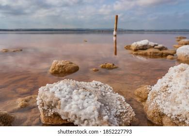 Rocks in a pink salt lake Laguna Rosa, Torrevieja