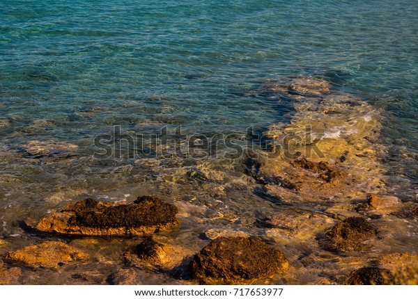 Rocks and reefs creating ideal living and feeding place for small fish off mediterranean coast of Greece