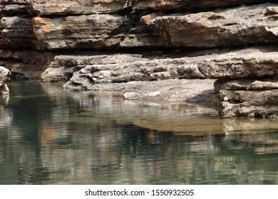 rocks reflecting in water at Big Cedar