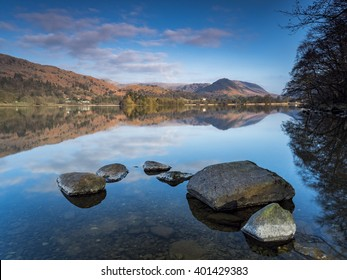Rocks and reflections in the calm waters of Grasmere.