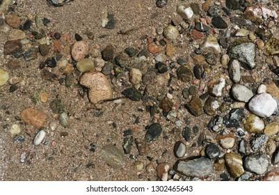 rocks in a river - Shutterstock ID 1302465643