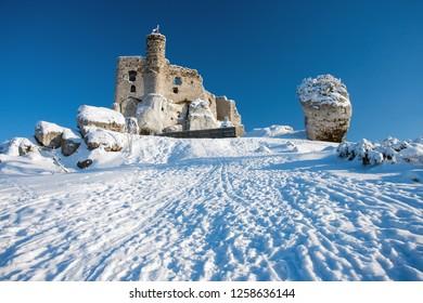 rocks and the ruins of the castle in Mirow in the winter, Jura Krakowsko Czestochowska region, Poland