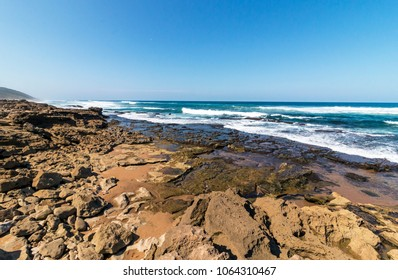 Rocks sand ocean and blue coastal skyline at Mission Rocks beach near Cape Vidal in Isimangaliso Wetland Park in Zululand. South Africa