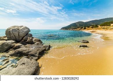 Rocks and sand in Porto Sa Ruxi beach in Villasimius. Sardinia, Italy