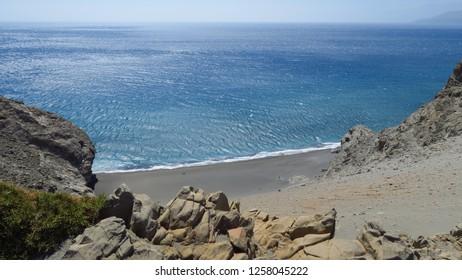 rocks sand and sea