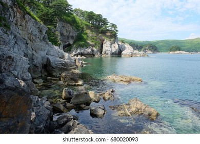 Rocks, sea, clean water. Gamov Peninsula. Primorye. Russia.