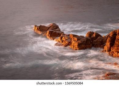rocks in the sea at dawn, Freycinet