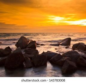 Rocks, sea, sunset on the  Tropical sea beach
