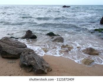Rocks and sea.  Surf. Coast. Rocks in water. Rocks at sea. Waves. Coastal waves.  Kazantip. Crimea.