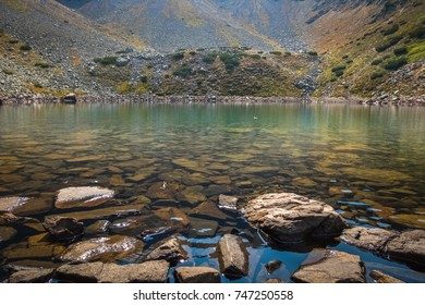 Rocks at the shore of a glacial lake high in the Mountains.