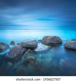 Rocks, soft sea and clouds in the sky, beautiful landscape in long exposure photography. Castiglioncello, Tuscany, Italy.