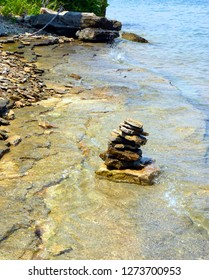 Rocks stacked on beach