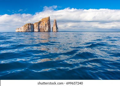 Rocks stick out of the water .. Pacific Ocean. Ecuador. The Galapagos Islands. Isla San Cristobal Island